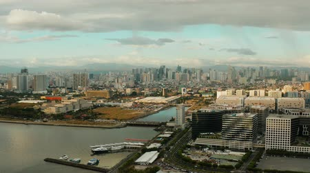 metropolitan area : Manila city with skyscrapers, modern buildings and Makati business center at sunset, aerial drone. Travel vacation concept Stock Footage