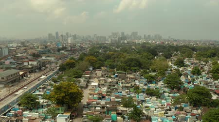 metropolitan area : The city of Manila, the capital of the Philippines and Manila North Cemetery, top view. Modern buildings in the city center. Stock Footage