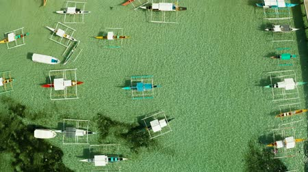 travel theme : Tourist boats in the turquoise water of the lagoon., aerial view. Summer and travel vacation concept.