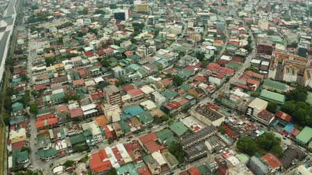 metro manila : Manila city view from above with streets and buildings in the Makati business center.. Travel vacation concept. Stock Footage