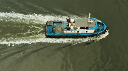 tow : Tugboat on the river surface, aerial view. Manila, Philippines