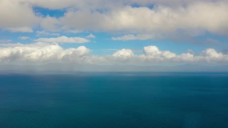 çare : Time lapse: Sea surface with waves against the blue sky with clouds, aerial view. Water cloud horizon background. Blue sea water with small waves against sky. Stok Video