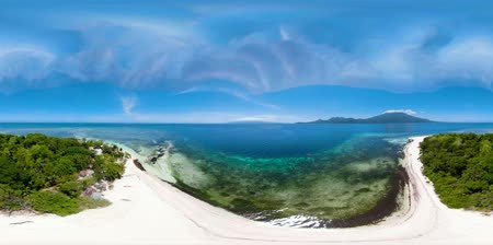 island hopping : Tropical island in the blue sea with coral reef, 360VR top view. Small island with sandy beach. Summer and travel vacation concept, Mantigue island, Philippines, Mindanao Stock Footage