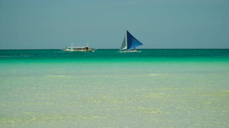 boracay : Seascape: tropical beach and sailing yacht in crystal clear turquoise water. Summer and travel vacation concept. Boracay, Philippines