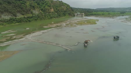 dredging : Aerial view excavator and heavy equipment, dredging and deepening channel mountain river. Heavy dredging machine on a river bank. Excavator dredge a river. Philippines, Luzon.
