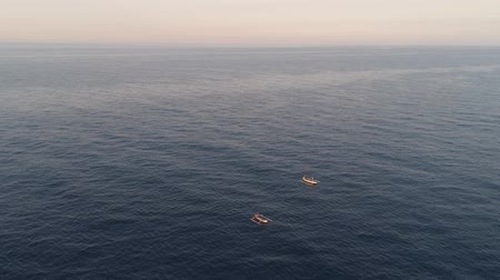 pescador : small fishing boat in sea. aerial view indonesian fishermen on boat in ocean bali, indonesia