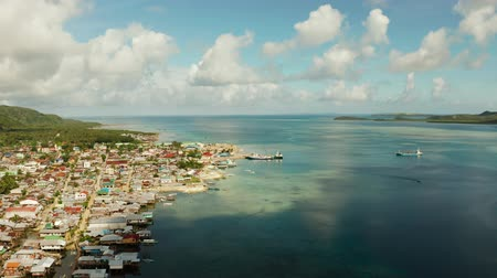 ferry terminal : Passenger port with ferries and cargo ships on the island of Siargao,aerial view. Dapa Ferry Terminal. Siargao, Philippines. Stock Footage