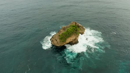kalker : Small rocky island in the ocean surrounded by water, top view. Siargao, Philippines.