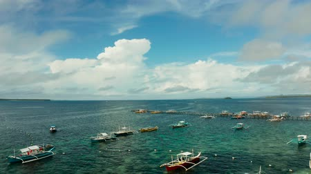 luna : Motor boats in blue water on a tropical beach, aerial view. Summer and travel vacation concept. Stock Footage