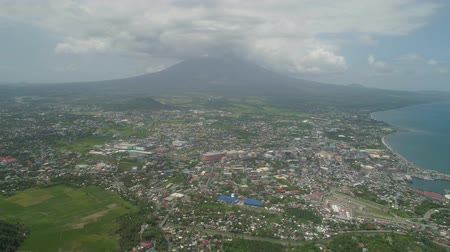 legazpi : Aerial view city Legazpi against Mayon volcano. Tropical landscape city near volcano on seashore, Philippines, Luzon.