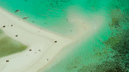 mindanao : Sandy white island with beach and sandy bar in the turquoise atoll water, aerial drone. Sandbar Atoll. Tropical island and coral reef. Summer and travel vacation concept, Camiguin, Philippines.