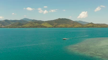 palawan : Honda bay with boats and sea with blue water and tropical islands covered with forest. aerial view, seascape. Puerto princesa, Palawan, Philippines. Stock Footage