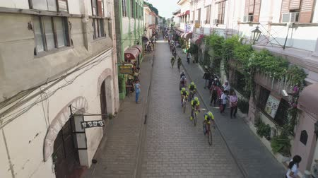 racers : Cycling competitions March 3rd, 2018 hrough streets in the old city Vigan, Philippines. Aerial view of group of cyclist at professional race. Cyclist athletes riding a race at high speed. Bicycle race. Luzon.