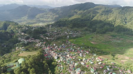 dağlık : Aerial view town Sagada, located in mountainous province of Philippines. City in valley among mountains covered with forest. Stok Video