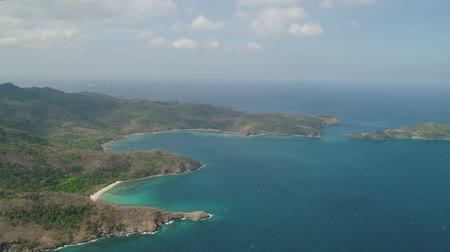 zátoka : Aerial view coastline with tropical beach, island Limbones, lagoons and coral reefs. Neela cove, Philippines, Luzon. Coast ocean with turquoise water. Tropical landscape in Asia. Dostupné videozáznamy