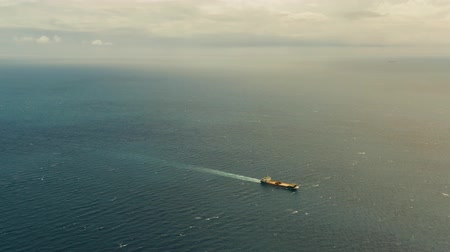 kosmická loď : Cargo ship in the open blue sea against the background of the cloudy sky, aerial view.