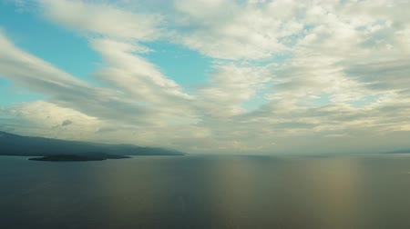 cebu : Cloud scape: Blue sky with clouds over the sea and islands, aerial view. Seascape: Ocean and sky, Cebu, Philippines. Stock Footage