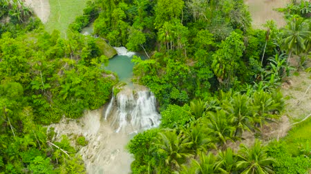 cebu : Aerial view of Lusno waterfalls in a mountain gorge in the tropical jungle, Philippines, Cebu. Waterfall in the tropical forest. Stock Footage