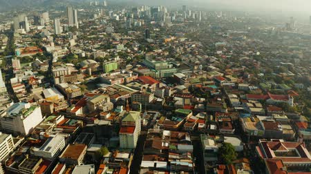 cebu : Cebu City, a major city on the island of Cebu, with skyscrapers and residential buildings in the early morning. Philippines. Stock Footage