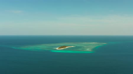 island hopping : Tropical island Canimeran with sandy beach in the blue sea with coral reef, top view. Summer and travel vacation concept. Balabac, Palawan, Philippines. Stock Footage