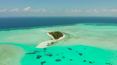 balabac : Tropical island with a paradise beach on the coral atoll with turquoise water, top view. Onok Islan, Balabac, Philippines. Summer and travel vacation concept