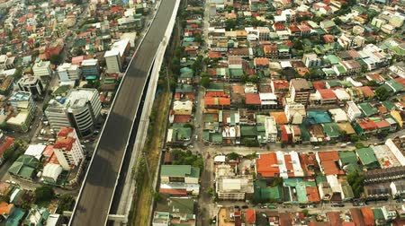 metropolitan area : Streets and houses with dense buildings in the city of Manila, Philippines, aerial view. Travel vacation concept.