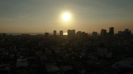 metro manila : Aerial view of Panorama of Manila city with skyscrapers silhouettes. Skyscrapers and business centers in a big city. Travel vacation concept Stock Footage