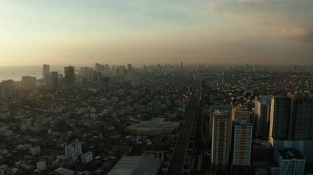metropolitan area : Aerial view of Panorama of Manila city at sunset. Skyscrapers and business centers in a big city. Travel vacation concept