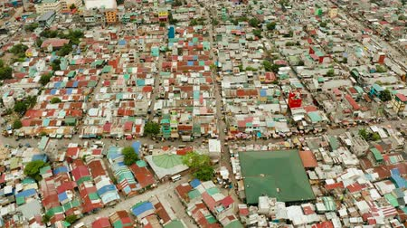 slum house : Poor district and slums with shacks in a densely populated area of Manila aerial view. Stock Footage
