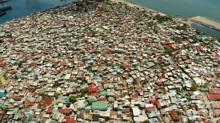 slum : Poor district and slums with shacks in a densely populated area of Manila aerial view. Stock Footage
