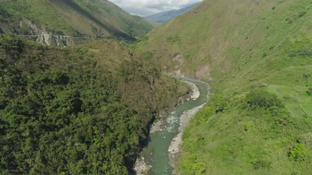 luzon : Aerial view mountain river in cordillera gorge, mountains covered forest, trees. Cordillera region. Luzon, Philippines. Mountain landscape. Stock Footage
