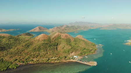 chiringuito : aerial view seascape bay with islands and mountains in province of Palawan. Busuanga, Philippines. Seascape, islands covered with forest, sea with blue water. tropical landscape, travel concept