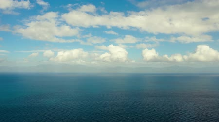nublado : Sea surface with waves against the blue sky with clouds timelapse, aerial view. Water cloud horizon background. Blue sea water with small waves against sky.