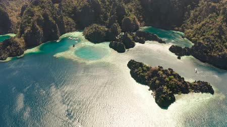 chiringuito : Aerial drone lagoons and coves with blue water among the rocks. lagoon, mountains covered with forests. Seascape, tropical landscape. Palawan, Philippines, Busuanga