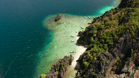 palawan : aerial view tropical lagoon with sandy beach surrounded by cliffs. El nido, Philippines, Palawan. beautiful lagoon and karst scenery.