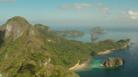 island hopping : aerial view Seascape with tropical bay, rocky islands, ocean blue water. islands and mountains covered with tropical forest. El nido, Philippines, Palawan. Tropical Mountain Range