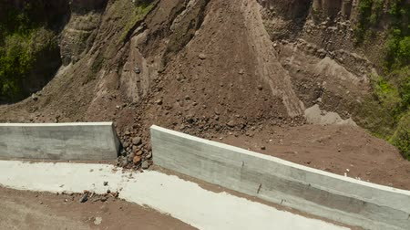 landslide : Anti-landslide concrete wall prevent protect against rock slides, aerial view. Rockfall protection. Mountain landslide stone slopes threaten to block roads