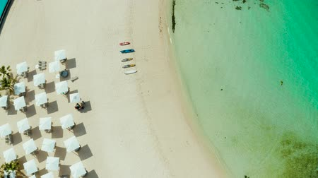 zátoka : Tropical beach with sun beds near the lagoon with turquoise water Boracay, Philippines, aerial view. Seascape with beach on tropical island. Summer and travel vacation concept. Dostupné videozáznamy