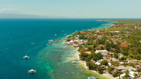 cebu : Coral reef and turquoise water with Philippine boats in the famous diving spot of Moalboal, Cebu. Aerial view, Summer and travel vacation concept