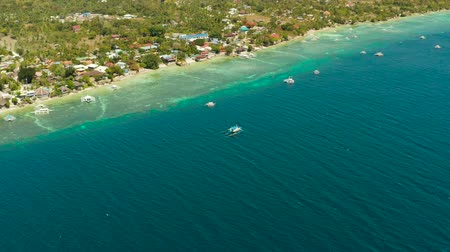 cebu : Shore with hotels near coral reef and diving boats, Moalboal, Philippines. Aerial view, Summer and travel vacation concept. Stock Footage