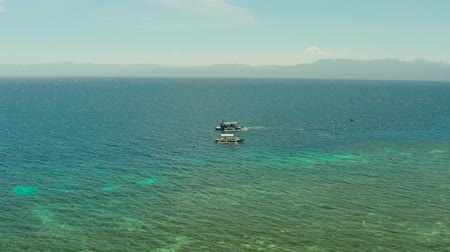 cebu : Blue lagoon with coral reef and turquoise water with Philippine boats, aerial view. Moalboal, Philippines. Summer and travel vacation concept.