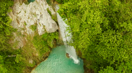 cebu : Aerial view of Inambakan waterfalls in a mountain gorge in the tropical jungle, Philippines, Cebu. Waterfall in the tropical forest.