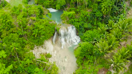 cebu : Beautiful waterfall in green forest, top view. Tropical Lusno falls in mountain jungle, Philippines, Cebu. Waterfall in the tropical forest.