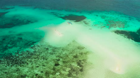 balabac : Sand bar among coral reefs, aerial view. Small sandy beach on a coral atoll in turquoise water. Summer and travel vacation concept. Balabac, Palawan, Philippines.