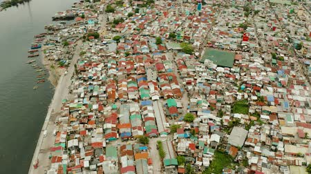 slum house : Slums in Manila near the port. River polluted with plastic and garbage. Manila, Philippines. Stock Footage