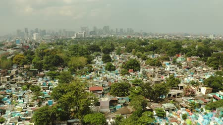 metropolitan area : Manila North Cemetery and Makati City is one of the most developed business district of Metro Manila and the entire Philippines. Travel vacation concept Stock Footage