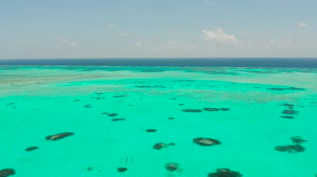 balabac : Atoll with coral reef and turquoise water against the sky with clouds top view. Summer and travel vacation concept. Balabac, Palawan, Philippines
