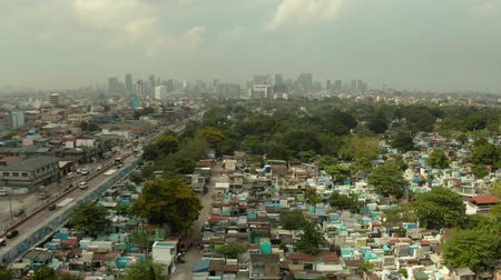 霊廟 : Manila North Cemetery and Cityscape of Makati, the business center of Manila, view from above. Asian metropolis. Travel vacation concept.