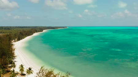 island hopping : Travel concept: blue sea and sand beach on a tropical island. Punta Sebaring, Balabac, Palawan. Summer and travel vacation concept. Stock Footage