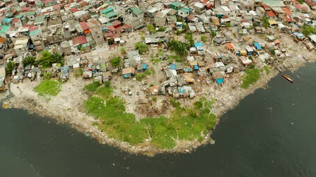 keet : Poor district and slums in Manila with shacks and buildings. Manila, Philippines. Stockvideo